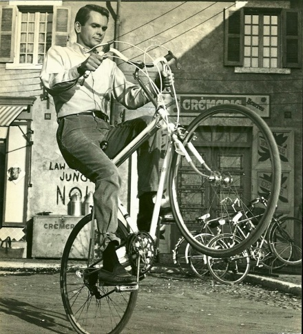 Dean Jones wheelies a bike, 1967